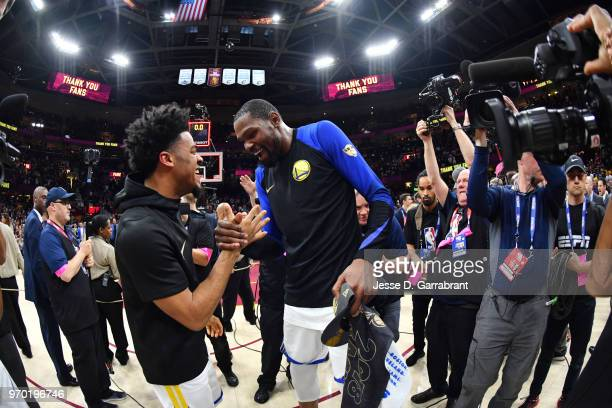 Quinn Cook and Kevin Durant of the Golden State Warriors exchange a handshake after defeating the Cleveland Cavaliers in Game Four of the 2018 NBA...