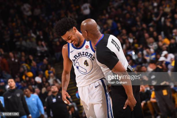 Quinn Cook and Referee Dedric Taylor talk during the game against the Sacramento Kings on March 16 2018 at ORACLE Arena in Oakland California NOTE TO...