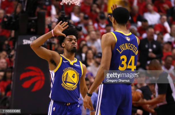 Quinn Cook and Shaun Livingston of the Golden State Warriors celebrate the play against the Toronto Raptors in the second half during Game Two of the...
