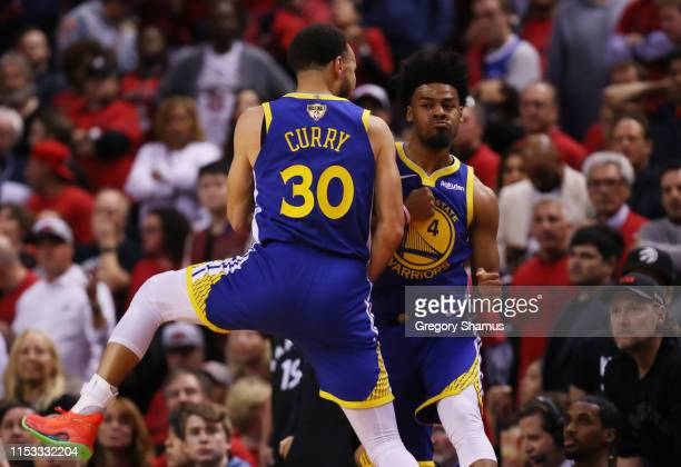 Quinn Cook and Stephen Curry of the Golden State Warriors celebrate the play against the Toronto Raptors in the second half against the Toronto...