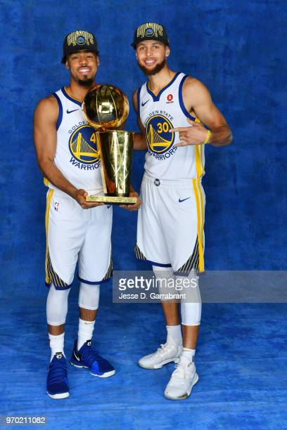 Quinn Cook and Stephen Curry of the Golden State Warriors poses for a portrait with the Larry O'Brien Championship trophy after defeating the...