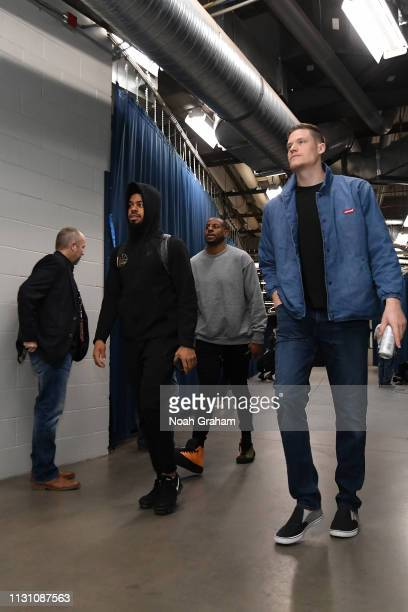 Quinn Cook Andre Iguodala and Jonas Jerebko of the Golden State Warriors arrive to the game against the Oklahoma City Thunder on March 16 2019 at...