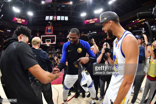 Quinn Cook Kevin Durant and Stephen Curry of the Golden State Warriors react after defeating the Cleveland Cavaliers in Game Four of the 2018 NBA...