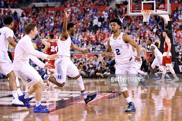 Quinn Cook of the Duke Blue Devils celebrates with teammates after defeating the Wisconsin Badgers during the NCAA Men's Final Four National...