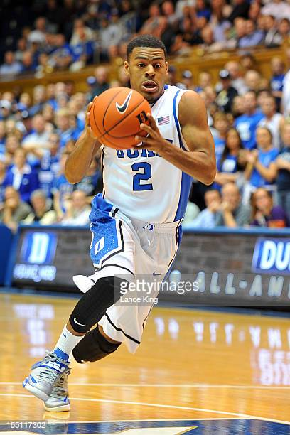 Quinn Cook of the Duke Blue Devils drives toward the hoop against the WinstonSalem State Rams at Cameron Indoor Stadium on November 1 2012 in Durham...
