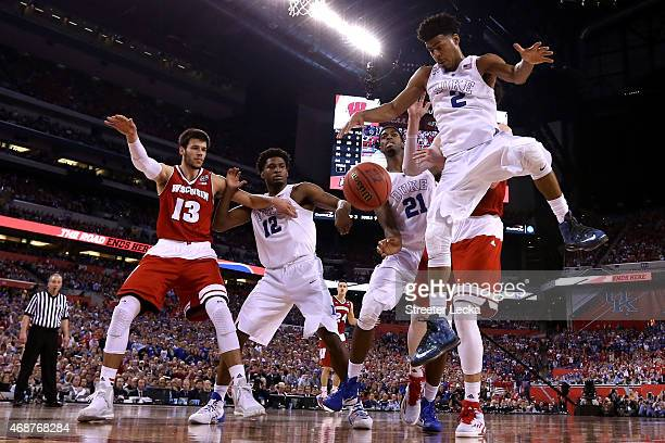 Quinn Cook of the Duke Blue Devils goes for a loose ball against Frank Kaminsky of the Wisconsin Badgers in the second half during the NCAA Men's...