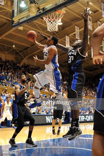 Quinn Cook of the Duke Blue Devils goes to the hoop against Chudier Pal of the UNC Asheville Bulldogs at Cameron Indoor Stadium on November 18 2013...