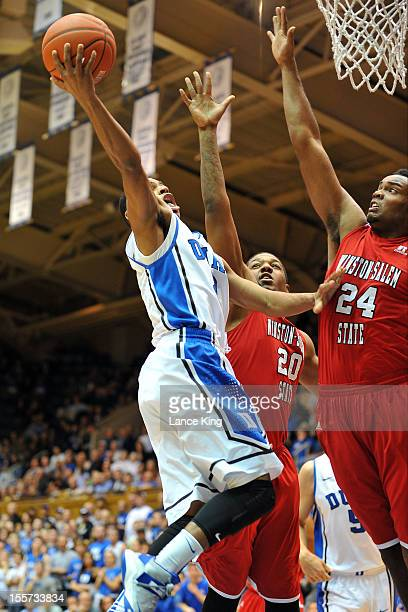 Quinn Cook of the Duke Blue Devils goes to the hoop against Stephon Platt and Kimani Hunt of the WinstonSalem State Rams at Cameron Indoor Stadium on...