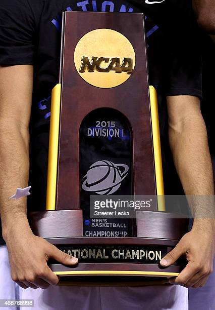 Quinn Cook of the Duke Blue Devils holds the championship trophy after defeating the Wisconsin Badgers during the NCAA Men's Final Four National...