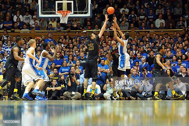Quinn Cook of the Duke Blue Devils puts up a shot against Alex Len and Nick Faust of the Maryland Terrapins at Cameron Indoor Stadium on January 26...