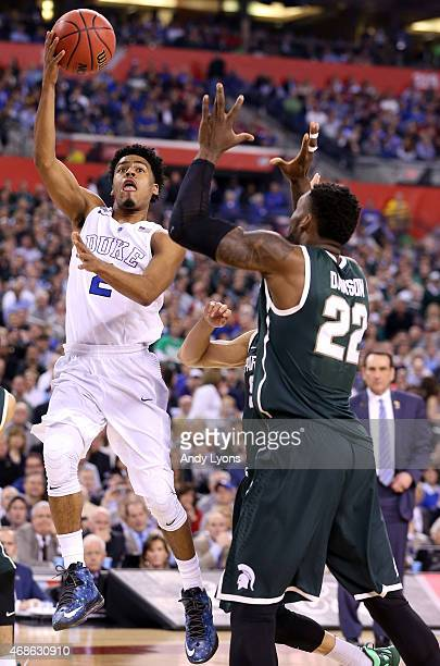 Quinn Cook of the Duke Blue Devils shoots against Branden Dawson of the Michigan State Spartans in the second half during the NCAA Men's Final Four...