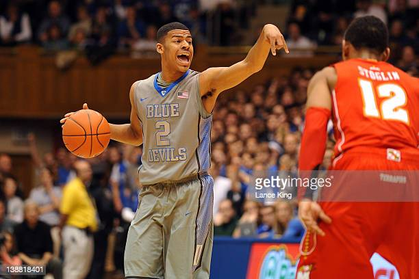 Quinn Cook of the Duke Blue Devils signals a play while defended by Terrell Stoglin of the Maryland Terrapins at Cameron Indoor Stadium on February...