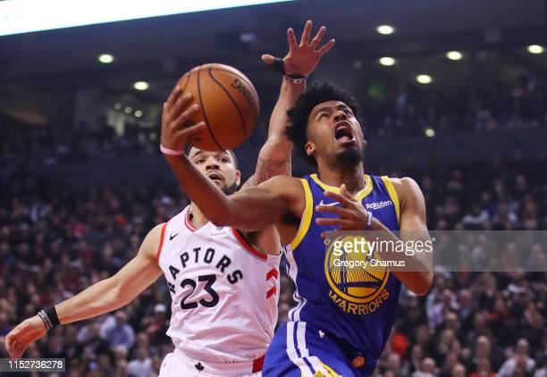 Quinn Cook of the Golden State Warriors attempts a shot against Fred VanVleet of the Toronto Raptors in the second quarter during Game One of the...