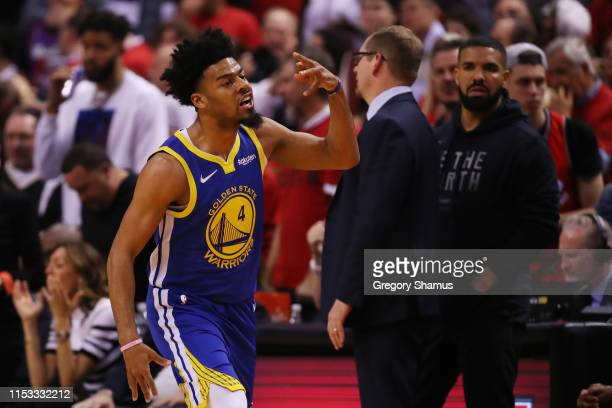 Quinn Cook of the Golden State Warriors celebrates against the Toronto Raptors in the second half during Game Two of the 2019 NBA Finals at...