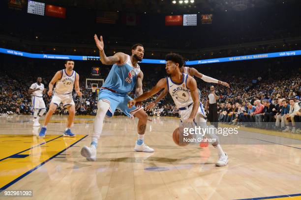 Quinn Cook of the Golden State Warriors handles the ball during the game against the Sacramento Kings on March 16 2018 at ORACLE Arena in Oakland...