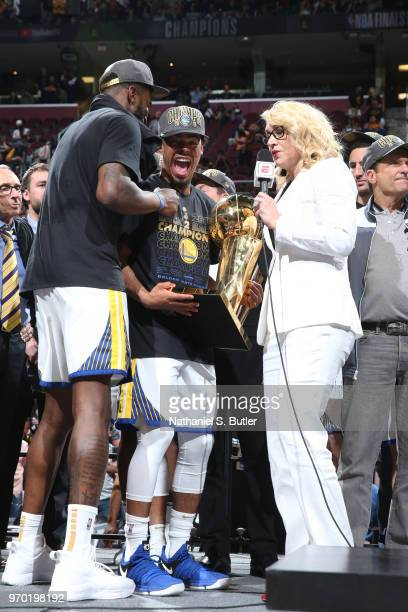 Quinn Cook of the Golden State Warriors holds the Larry O'Brien Championship Trophy after Game Four of the 2018 NBA Finals against the Cleveland...