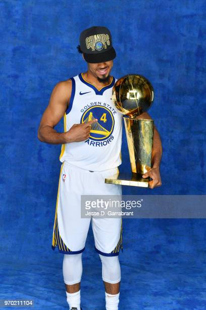 Quinn Cook of the Golden State Warriors poses for a portrait with the Larry O'Brien Championship trophy after defeating the Cleveland Cavaliers in...