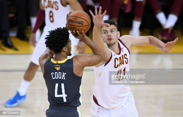 Quinn Cook of the Golden State Warriors shoots against Ante Zizic of the Cleveland Cavaliers in Game 2 of the 2018 NBA Finals at ORACLE Arena on June...