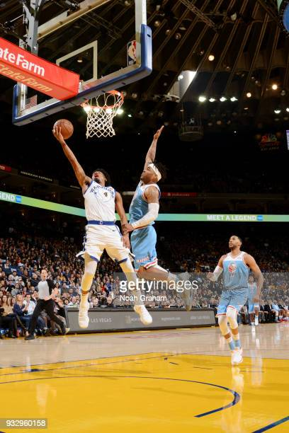 Quinn Cook of the Golden State Warriors shoots the ball during the game against the Sacramento Kings on March 16 2018 at ORACLE Arena in Oakland...