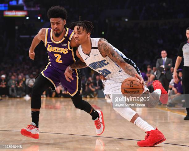Quinn Cook of the Los Angeles Lakers guards Markelle Fultz of the Orlando Magic as he drives to the basket in the first half of the game at Staples...