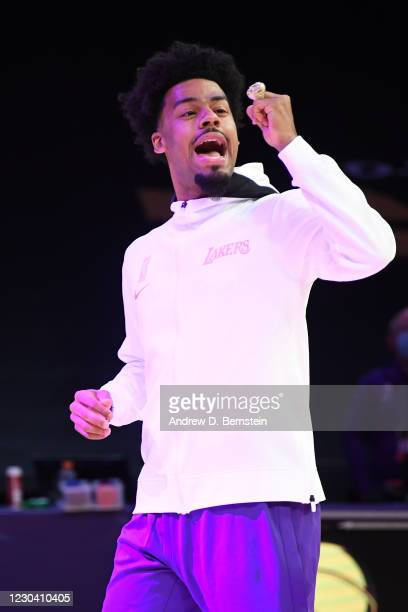 Quinn Cook of the Los Angeles Lakers reacts as he gets his 2019-20 NBA Championship ring during the ring ceremony before the game against the LA...