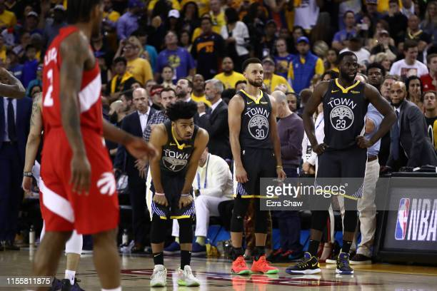 Quinn Cook Stephen Curry and Draymond Green of the Golden State Warriors react late in the game against the Toronto Raptors during Game Six of the...