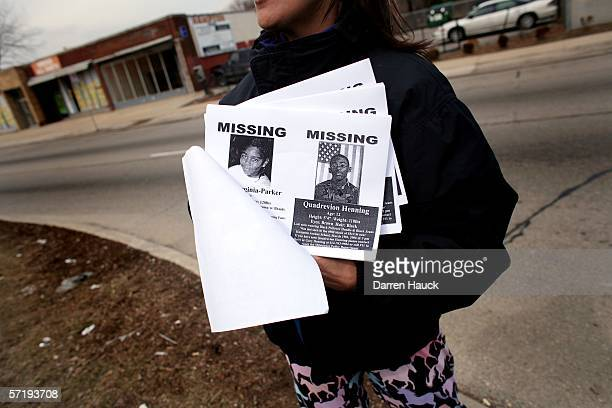 Quinn Harris 10yearsold volunteers his time and hands out flyers with his mother at the intersection of 51st and Hampton near the home of the missing...