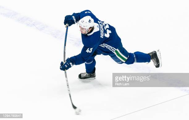 Quinn Hughes of the Vancouver Canucks shoots the puck on the first day of the Vancouver Canucks NHL Training Camp on January 2021 at Rogers Arena in...