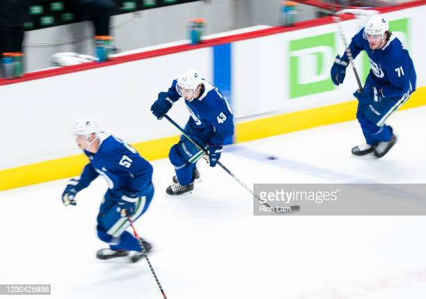 Quinn Hughes of the Vancouver Canucks skates with teammates Tyler Myers and Zack Macewen on the first day of the Vancouver Canucks NHL Training Camp...