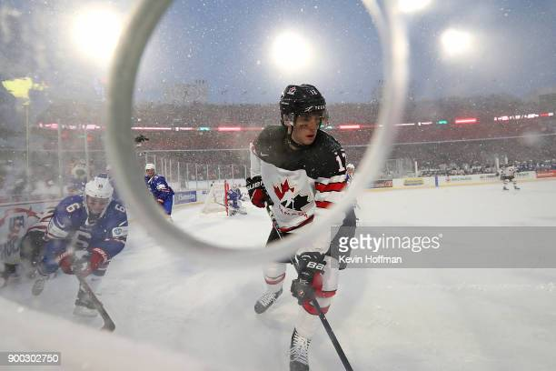 Quinn Hughes of United States and Boris Katchouk of Canada during the IIHF World Junior Championship at New Era Field on December 29 2017 in Buffalo...