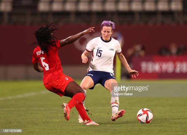 Quinn of Team Canada is challenged by Megan Rapinoe of Team United States during the Women's Semi-Final match between USA and Canada on day ten of...