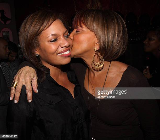 Quinn Rhone and Sylvia Rhone attend Sylvia Rhones' surprise birthday party at Norwood on March 10 2009 in New York City New York