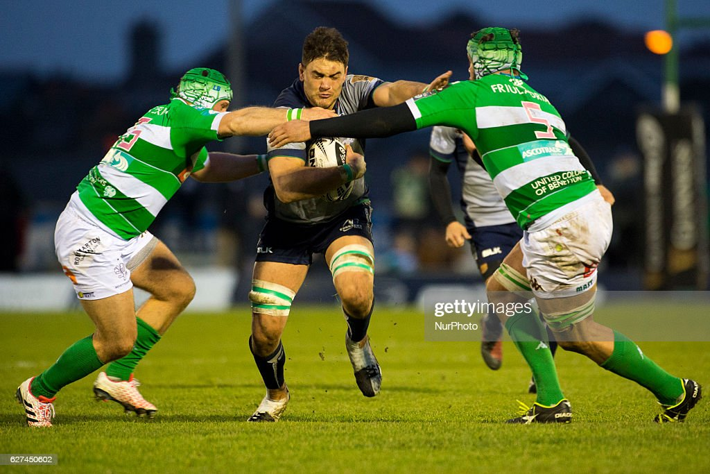 Quinn Roux of Connacht tackled by Luca Bigi and Marco Fuser of Benetton during the Guinness PRO12 Round 10 match between Connacht Rugby and Benetton Treviso at the Sportsground in Galway, Ireland on December 3, 2016