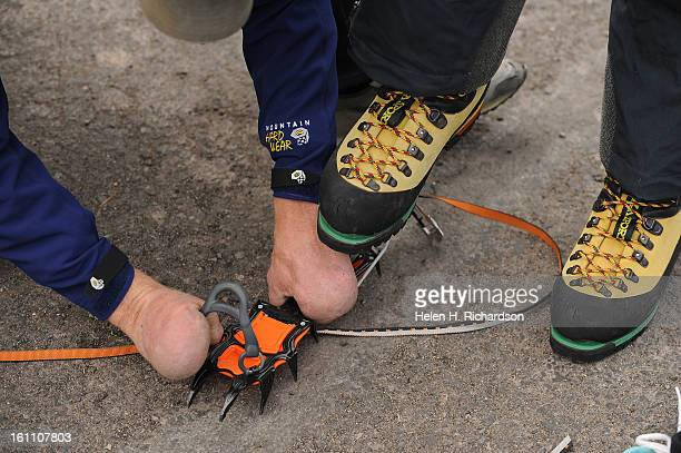 Quinn Simons who lost all of his fingers and both of his feet to frostbite while climbing in China gets crampons prepared before heading out for the...
