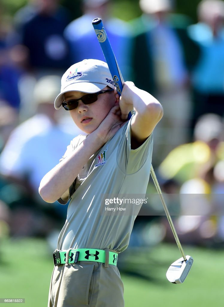 Quinn Thomas reacts to his putt as he competes in the 10-11 boy category during the Drive, Chip and Putt Championship at Augusta National Golf Club on April 2, 2017 in Augusta, Georgia.