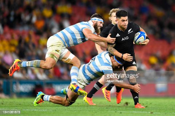 Quinn Tupaea of the All Blacks is tackled during The Rugby Championship match between the Argentina Pumas and the New Zealand All Blacks at Suncorp...