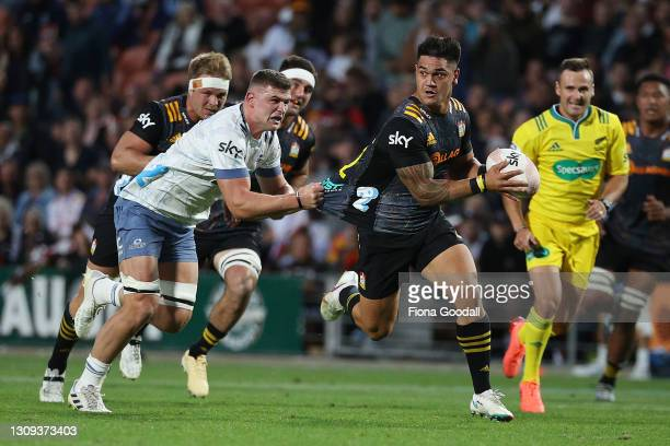 Quinn Tupaea of the Chiefs is tackled by Dalton Papalii of the Blues during the round 5 Super Rugby Aotearoa match between the Chiefs and the Blues...
