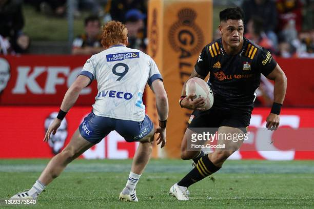 Quinn Tupaea of the Chiefs steps Finlay Christie of the Blues during the round 5 Super Rugby Aotearoa match between the Chiefs and the Blues at FMG...