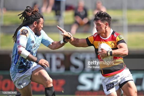 Quinn Tupaea of Waikato fends off Rene Ranger of Northland during the Mitre 10 Cup Championship Semi Final match between Waikato and Northland at FMG...
