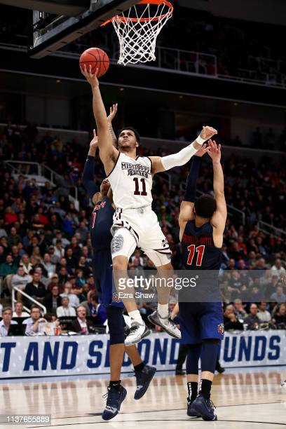 Quinndary Weatherspoon of the Mississippi State Bulldogs goes up for a shot against Georgie PachecoOrtiz and Caleb Homesley of the Liberty Flames...
