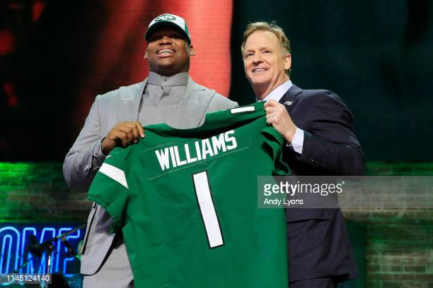 Quinnen Williams of Alabama poses with NFL Commissioner Roger Goodell after he was picked overall by the New York Jets during the first round of the...