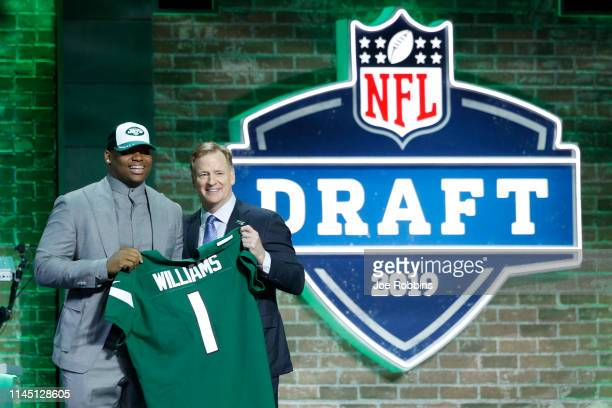 Quinnen Williams of Alabama with NFL commissioner Roger Goodell after being announced as the third overall pick in the first round of the NFL Draft...