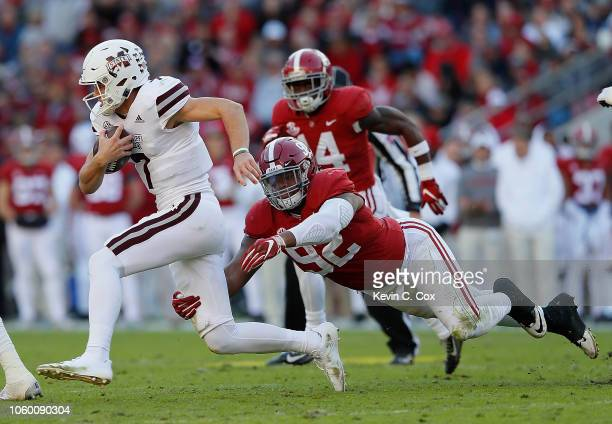 Quinnen Williams of the Alabama Crimson Tide chases down Nick Fitzgerald of the Mississippi State Bulldogs at BryantDenny Stadium on November 10 2018...