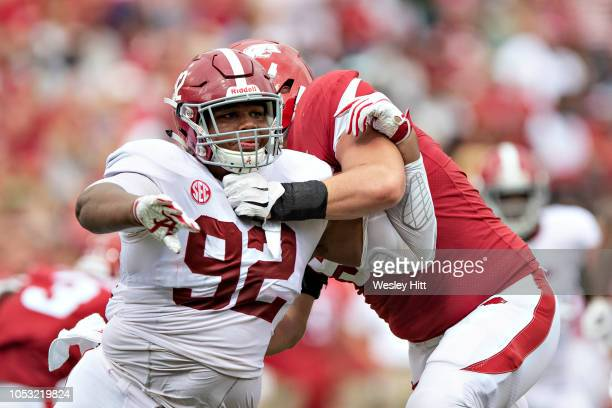Quinnen Williams of the Alabama Crimson Tide rushes the quarterback during a game against the Arkansas Razorbacks at Razorback Stadium on October 6...