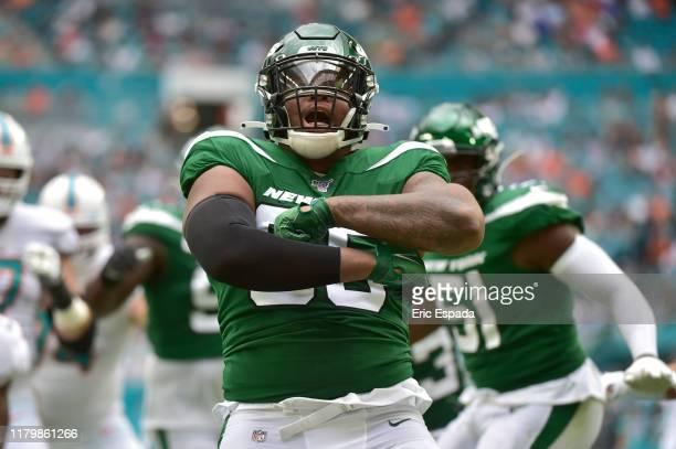 Quinnen Williams of the New York Jets celebrates after sacking Ryan Fitzpatrick of the Miami Dolphins during the first quarter of the game at Hard...