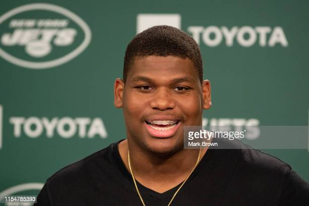 Quinnen Williams of the New York Jets speaks with the media before day two of mandatory minicamp at the Atlantic Health Jets Training Center on June...