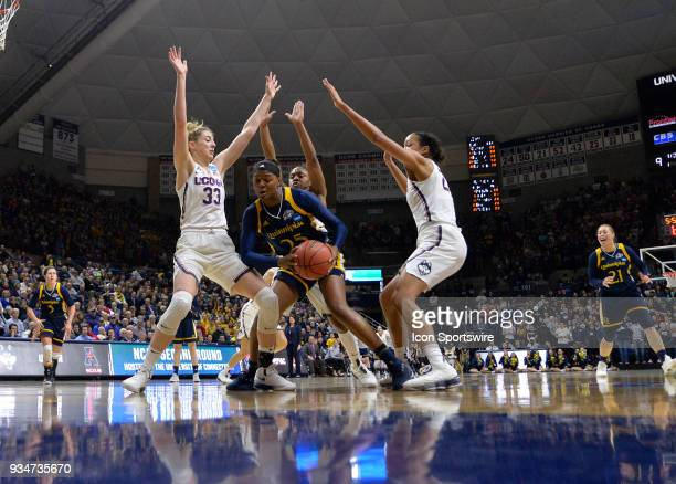 Quinnipiac Bobcats Guard Aryn McClure gets caught in a triple team of UConn Huskies Guard Katie Lou Samuelson UConn Huskies Forward Napheesa Collier...