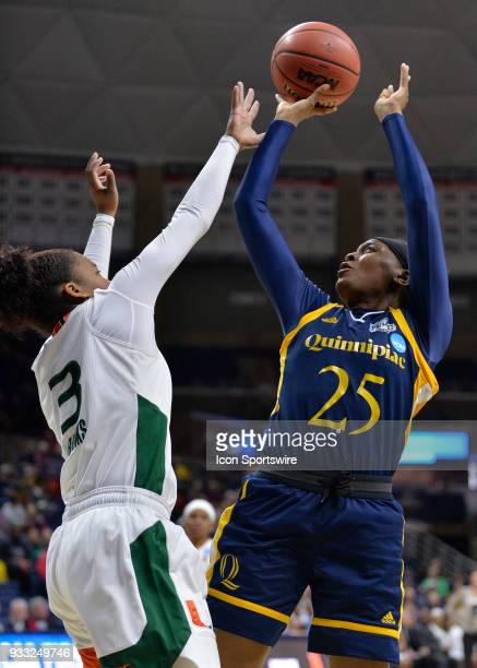 Quinnipiac Bobcats Guard Aryn McClure shoots over Miami Hurricanes Guard Jessica Thomas during the game as the Miami Hurricanes take on the...
