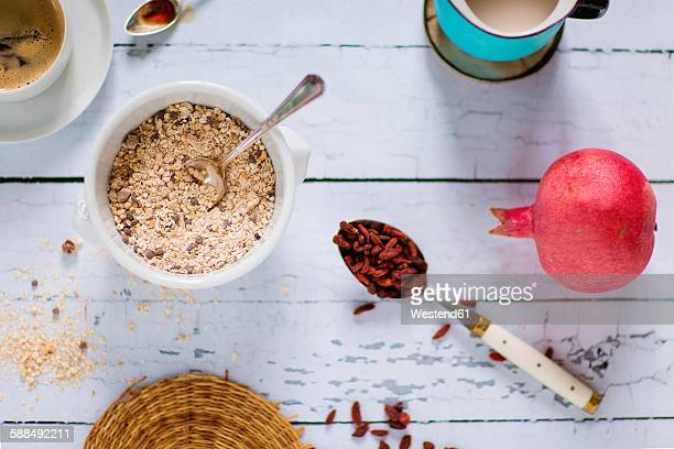 Quinoa breakfast bowl, rice milk, pomegranate, goji berries and coffee