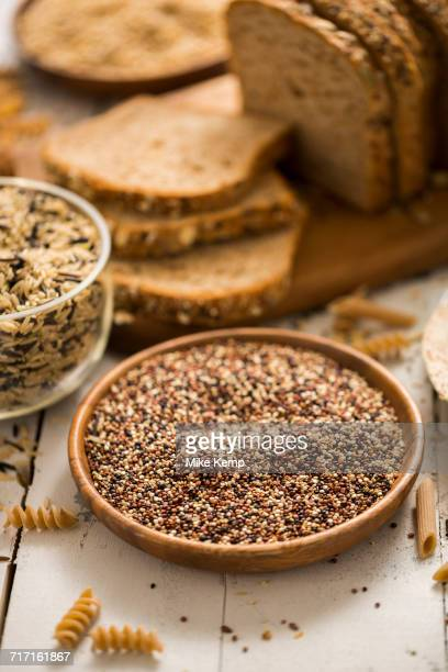 Quinoa in bowl and sliced brown bread in background